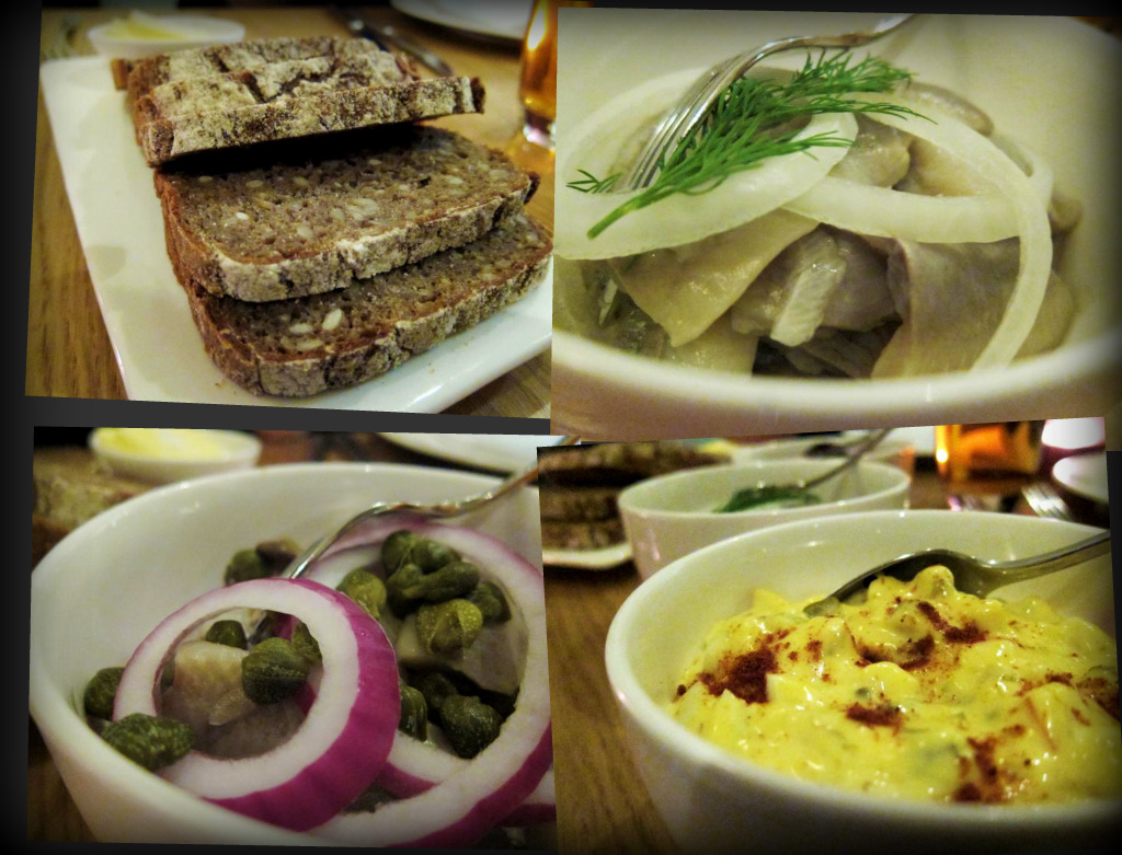 freshly baked dark rye bread; white herring; Christmas herring with capers; curry salad with apple