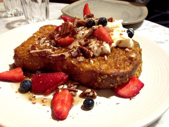 French toast with fresh berries, yoghurt, roasted pecans